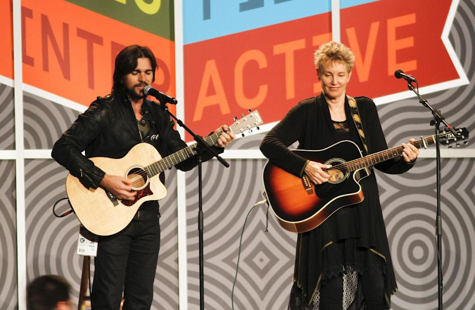 Colombian singer Juanes, left, and folk-singer Eliza Gilkyson perform a set of Woody Guthrie songs during the SXSW Music Festival in Austin, Texas on Thursday, March 15, 2012.(AP Photo/Jack Plunkett)