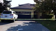 RCMP investgate at a home on Mission Springs Drive on Sept. 14, 2012, in Kelowna, B.C., after a 24-year-old man allegedly attacked his mother with a hammer.