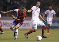 Panama's Rolando Escobar (R) fights for the ball with Costa Rica's Celso Borges during their 2014 World Cup qualifying soccer match at the National Stadium in San Jose June 18, 2013. REUTERS/Juan Carlos Ulate