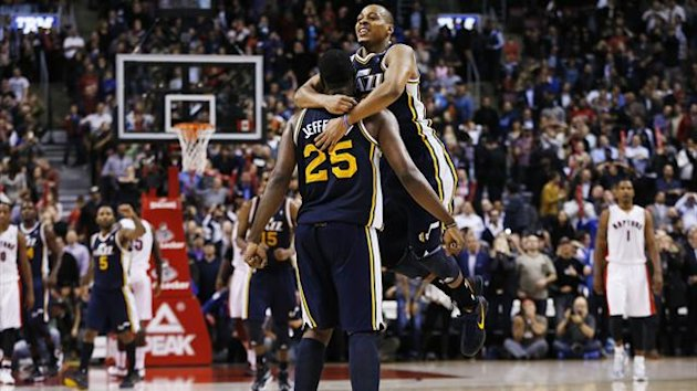 Utah Jazz's Al Jefferson (L) celebrates with team mate Randy Foye after Jefferson scored a three point shot to tie the game at the buzzer against the Toronto Raptors at the end of the second half of their NBA basketball game in Toronto (Reuters)