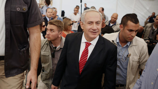 Surrounded by security guards, Israeli Prime Minister Benjamin Netanyahu visits the east Jerusalem Jewish neighborhood of Gilo, Tuesday, Oct. 23, 2012. Netanyahu vowed on Tuesday to continue building in the Jerusalem district days after European Union criticism because it is claimed by Palestinians. (AP Photo/Gali Tibbon, Pool)