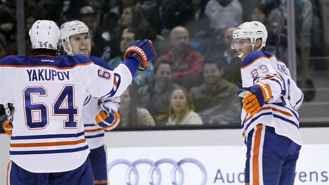Edmonton Oilers center Sam Gagner (89) celebrates after scoring against the San Jose Sharks with right wing Nail Yakupov (64) during the second period of an NHL hockey game in San Jose, Calif., Thursday, Jan. 31, 2013. (AP Photo/Tony Avelar)
