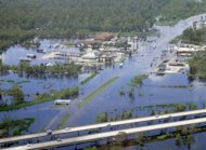 This Sept. 1, 2012 photo provided by the Louisiana Joint Information Center shows flooding in LaPlace, La. Louisiana State Police say Interstate 10, foreground, is open to traffic in both directions between New Orleans and Baton Rouge. Police spokesman Capt. Doug Cain said the highway was fully reopened just before 12 p.m. CDT Saturday. But he said police dispatchers continue to be swamped with calls about the status of the highway in the wake of Hurricane Isaac. (AP Photo/Louisiana Joint Information Center)
