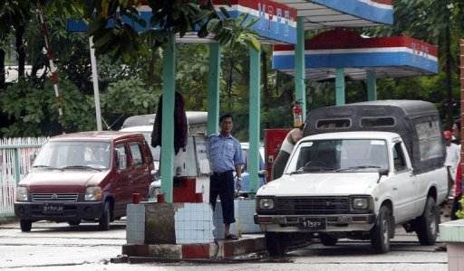 Cars queue up to fill tanks at a government-run petrol station in down town Yangon in 2007