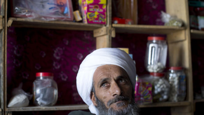 "In this Oct. 21, 2012 photo, Maullah Daoud, who together with Mohammed Haider runs a rickety shop in Marjah, Afghanistan's chaotic one-street bazaar, says he felt better during the Taliban. ""If you had a box of Afghanis on your head you could go to the farthest part of Marjah and no one would take it from you, even at night"".  In southern Helmand province, one of Afghanistan's deadliest battlefields, angry residents say 11 years of war has brought them widespread insecurity. Development that was promised hasn't materialized and the Taliban's rule is often said to be preferred. (AP Photo/Anja Niedringhaus)"