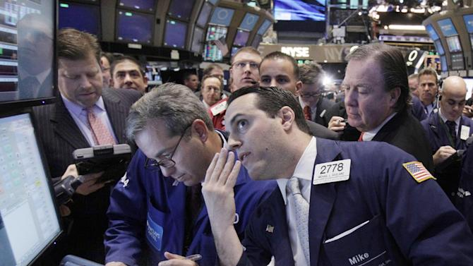 Specialist Michael Gagliano, foreground right, works at a post on the floor of the New York Stock Exchange during the IPO of Rose Rock Midstream, Friday, Dec. 9, 2011. U.S. stock indexes rose in early trading Friday after 26 European nations agreed to consider tying their economies together more closely in hopes of preventing another debt crisis. (AP Photo/Richard Drew)