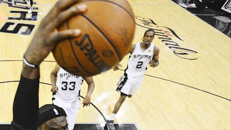Miami Heat's LeBron James (6) dunks against the San Antonio Spurs during the first half at Game 5 of the NBA Finals basketball series, Sunday, June 16, 2013, in San Antonio. (AP Photo/John G. Mabanglo, Pool)