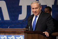 Israeli Prime Minister Benjamin Netanyahu addresses a meeting of his Likud party in Tel Aviv. Netanyahu called for early elections, suggesting he would seek a September vote instead of waiting until the scheduled October 2013 date