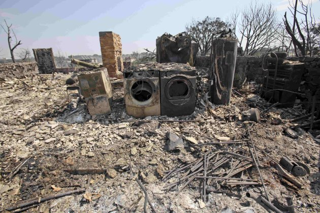 Charred appliances and a fireplace are all that remain of a home in Possum Kingdom Lake, Texas, Wednesday, Aug. 31, 2011, the day after a wildfire swept through the area. Some streets were virtually u
