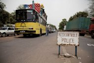 Traffic stands waiting at the Senegal-Guinea Bissau border crossing at Mpack after the border was closed following a coup in Guinea Bissau a day earlier. Leaders of Guinea-Bissau&#39;s military coup set out their terms for a &quot;unity government,&quot; a day after seizing control of the capital and capturing both the prime minister and interim president