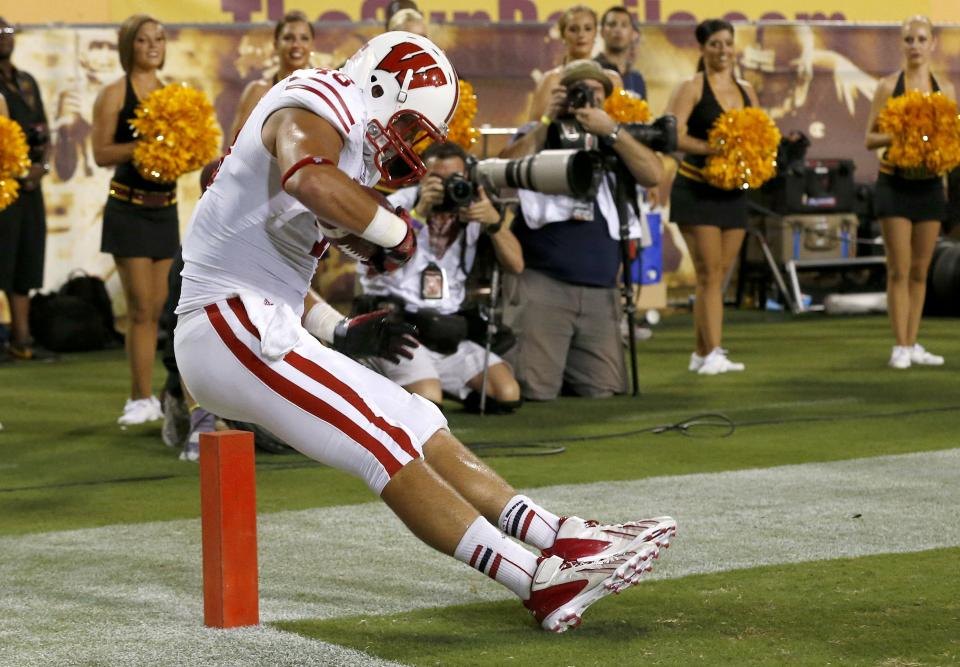 Wisconsin's Jacob Pedersen keeps his feet in as he makes a touchdown catch against Arizona State in the first half of an NCAA college football game on Saturday, Sept. 14, 2013, in Phoenix. (AP Photo/Ross D. Franklin)