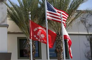 Flags flutter outside the Huy Fong Foods factory, maker of Sriracha hot chili sauce, in Irwindale