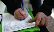 <p>Eric Holland writes his personal information on a sign-up sheet at the Office Depot booth during a job fair at Tellabs in Naperville, Illinois October 27, 2011. REUTERS/Frank Polich</p>