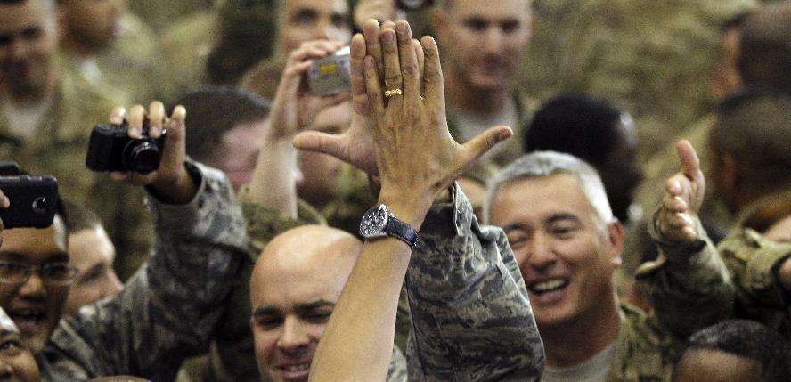 President Barack Obama high fives military personnel at Bagram Air Field, Afghanistan, Wednesday, May 2, 2012. (AP Photo/Charles Dharapak)