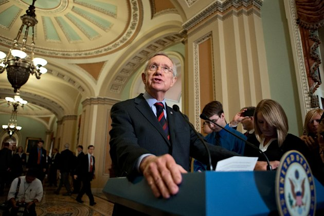 FILE - In this Sept. 19, 2012, file photo Senate Majority Leader Harry Reid, D-Nev., speaks with reporters following a Democratic strategy luncheon on Capitol Hill in Washington. The most partisan, least productive Congress in memory has skipped out of Washington so lawmakers can make their case for voters to re-elect them. The Senate closed the Capitol not long after sending President Barak Obama a spending bill that will make sure the government won't shut down Oct. 1, the start of the new budget year. The measure passed early Saturday by a 62-30 vote. AP Photo/J. Scott Applewhite, File)