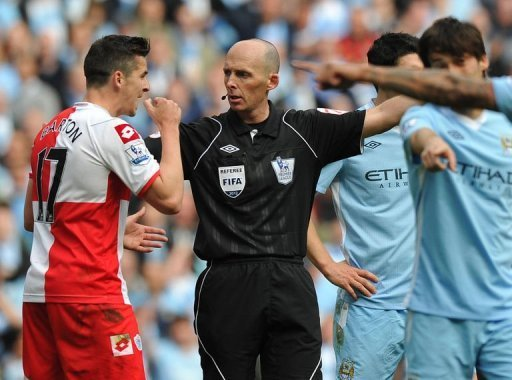Queens Park Rangers' Joey Barton (L) is sent off by referee Mike Dean