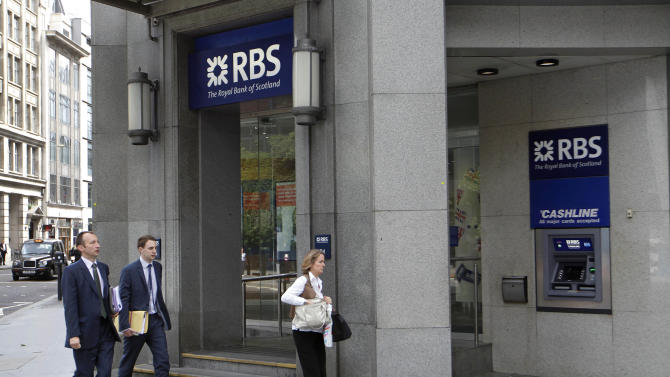 FILE - In this Friday, Aug. 3, 2012 file photo people walk by a branch of Royal Bank of Scotland (RBS) in the City of London. U.S. and U.K. authorities fined the Royal Bank of Scotland more than $610 million Wednesday for its role in the manipulation of a key global interest rate — with the bank pledging to make the rate-riggers and their managers foot the bill.  (AP Photo/Sang Tan, File)