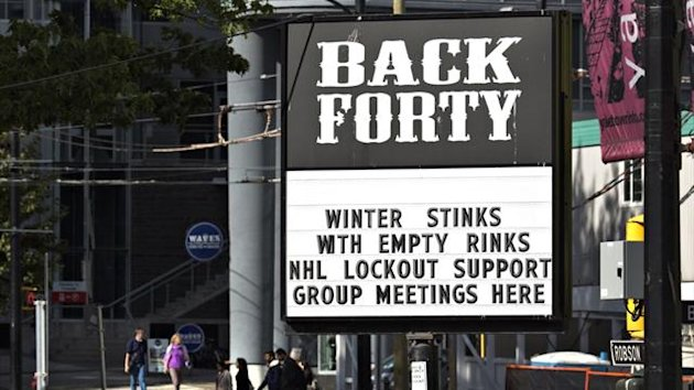 A pub near the home arena of the NHL Vancouver Canucks posts a sign in regarding the current league and players dispute (Reuters)
