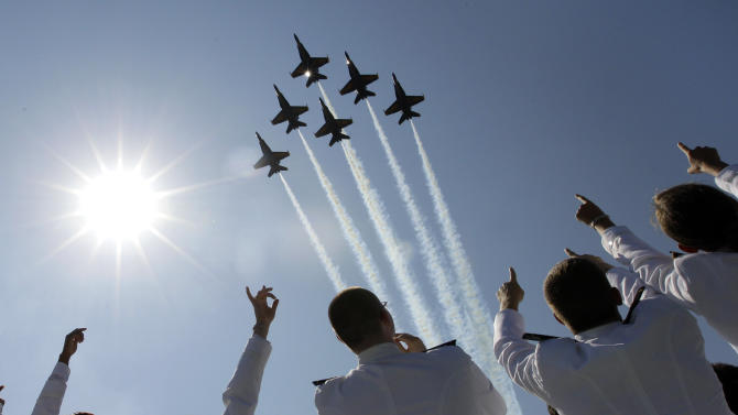 FILE - In a Tuesday, May 29, 2012 file photo, a formation of U.S. Navy Blue Angel fighter jets perform a flyover above graduating Midshipmen during the United States Naval Academy graduation and commissioning ceremonies in Annapolis, Md. The commander of Naval air forces announced on Tuesday, April 9, 2013 that the U.S. Navy has canceled the remainder of the elite Blue Angels demonstration team's 2013 season because of federal cuts. (AP Photo/Patrick Semansky, File)
