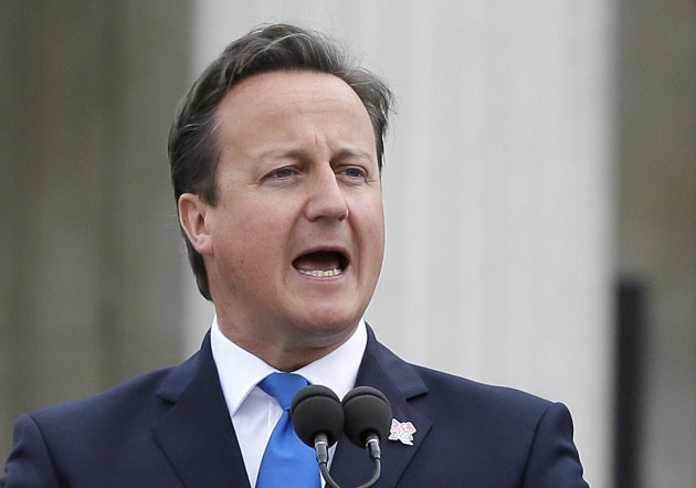 "FILE- Britain's Prime Minister David Cameron makes a speech ahead of the lighting of the Paralympic flame cauldron in Trafalgar Square, London, in this file photo dated Friday, Aug. 24, 2012. The long-serving member of Parliament and chairman of the Energy and Climate Change Committee, Tim Yeo, has commented publicly on Cameron's opposition to expanding London's Heathrow Airport, ""The prime minister must ask himself whether he is man or mouse,"" Yeo wrote in The Daily Telegraph newspaper published on Tuesday Aug. 28, 2012. (AP Photo/Kirsty Wigglesworth, file)"