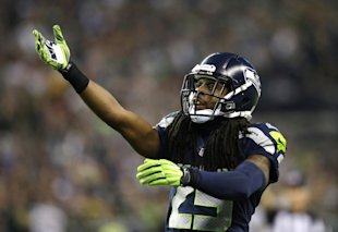 Richard Sherman didn't see much action his way on the field during pass plays Thursday. (AP)