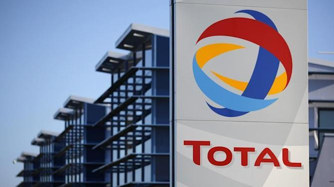 View of the logo of French oil giant Total in front of the oil refinery of Donges