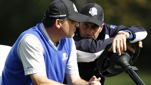Team Europe golfer Paul Lawrie of Scotland (L) talks with captain Jose Maria Olazabal of Spain (Reuters)