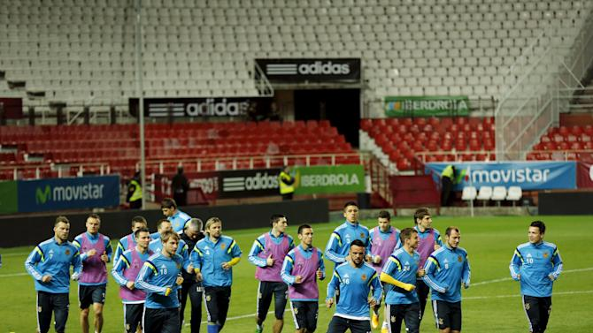 Ukraine's national soccer team players warm up during a training session ahead of Euro 2016 qualifier in Seville