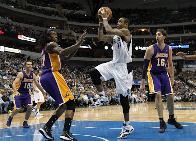 Dallas Mavericks guard Monta Ellis leaps to the basket for a shot attempt as Los Angeles Lakers' Jordan Hill, left, defends in the second half of an NBA basketball game, Tuesday, Nov. 5, 2013, in Dall