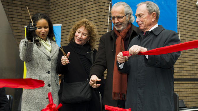 """IMAGE DISTRIBUTED FOR HARLEM SCHOOL OF THE ARTS - From left to right, Yvette L. Campbell, Lani Hall, Herb Albert and Mayor Michael R. Bloomberg cut the ribbon to officially open the """"Harlem School of the Arts - The Herb Alpert Center"""" building on Monday, March 11, 2013 in New York. (Photo by Charles Sykes/Invision for Harlem School of the Arts/AP Images)"""
