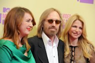 Singer Tom Petty, center, arrives with his wife Dana, right, and his daughter Adria at the MTV Video Music Awards on Thursday, Sept. 6, 2012, in Los Angeles. (Photo by Jordan Strauss/Invision/AP)