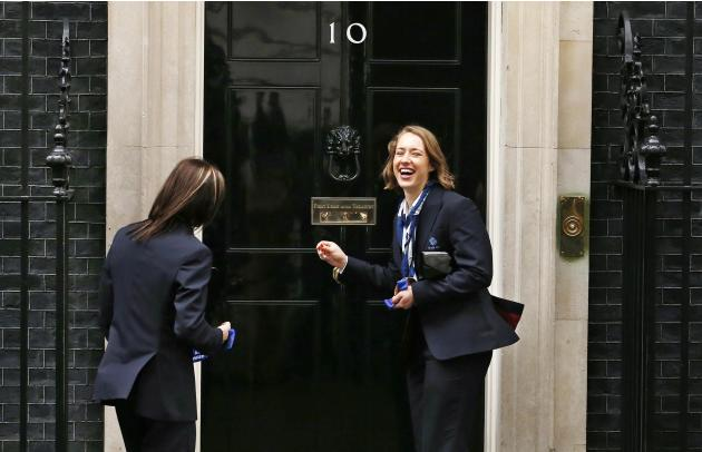 Britain's Olympic gold medallist skeleton racer Yarnold and women's curling captain bronze medallist Muirhead react after Yarnold knocked on the door of 10 Downing Street in London