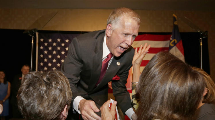 This May 6, 2014 file photo shows North Carolina House Speaker Thom Tillis greetings supporters at an election night rally in Charlotte, N.C., after winning the Republican nomination for the U.S. Senate. This year's U.S. Senate campaign in North Carolina and a few other crucial states will determine which party controls the Senate in the final two years of President Barack Obama's second term. For Republicans like Tillis it's all about tying Democrats to Obama, especially to his health care law that remains wildly unpopular among conservative voters. (AP Photo/Chuck Burton, File)