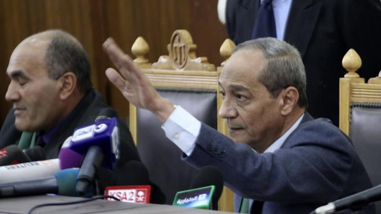 Judge Moustafa Mohammed Salama gestures while speaking during the trial of Muslim Brotherhood leaders in Cairo