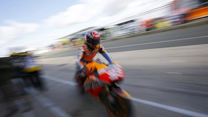 Honda MotoGP rider Marc Marquez of Spain enters his garage after the first practice session for the British Grand Prix at the Silverstone