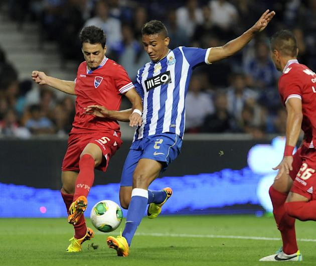 FC Porto's Danilo Silva, from Brazil, challenges Gil Vicente's Luis Martins, left, in a Portuguese League soccer match at the Dragao stadium in Porto, Portugal, Saturday, Sept. 14, 2013. Porto won 2-0