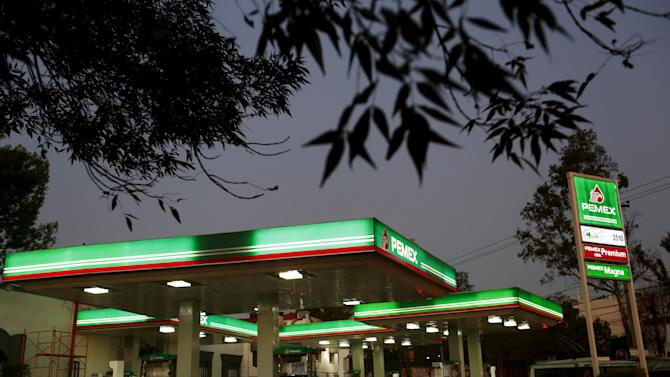 File photo of vehicles beside fuel pumps at a Pemex petrol station in Mexico City