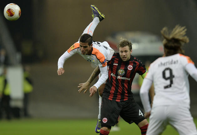 Apoel's Piersos Sotiriou, left, and Frankfurt's Marco Russ challenge for the ball during the Europa League Group F soccer match between Eintracht Frankfurt and Apoel FC in Frankfurt, Germany,