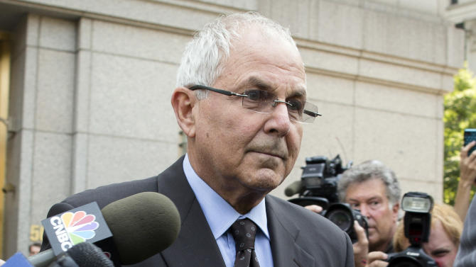 FILE - In this June 29, 2012 file photo, Peter Madoff leaves Federal Court in New York after pleading guilty to criminal charges. The suspense surrounding the sentencing of the brother of Ponzi king Bernard Madoff will largely be absent because a plea agreement makes a 10-year prison term all but certain. But drama will likely fill the courtroom Thursday, Dec. 20, 2012 in U.S. District Court in Manhattan anyway as 67-year-old Peter Madoff faces some of the heartbroken investors who lost their savings when the unprecedented fraud was revealed four years ago this month. (AP Photo/John Minchillo, File)