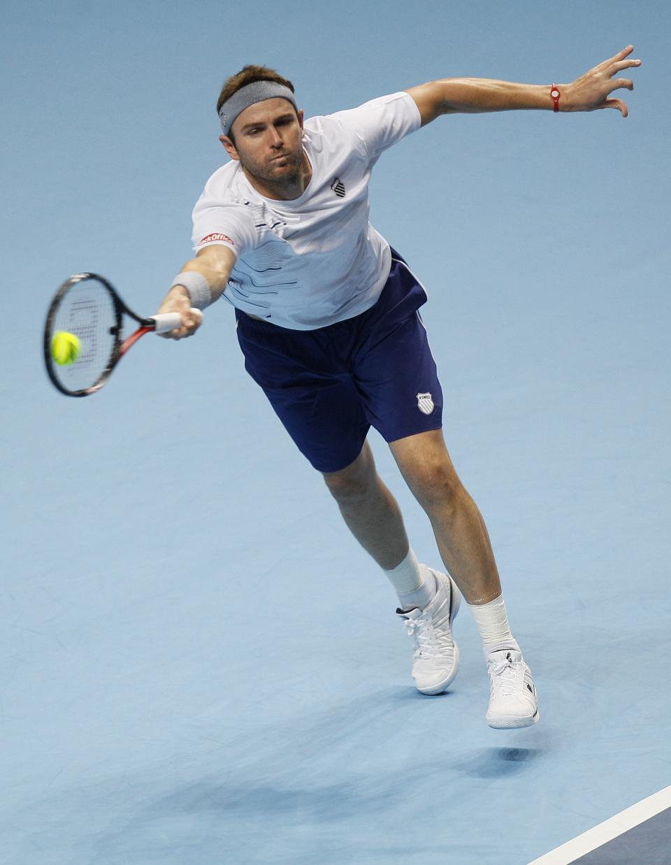 Mardy Fish of the U.S. plays a return to Jo-Wilfred Tsonga of France during their round robin singles tennis match against at the ATP World Tour Finals at O2 Arena in London, Tuesday, Nov. 22, 2011.  (AP Photo/Kirsty Wigglesworth)
