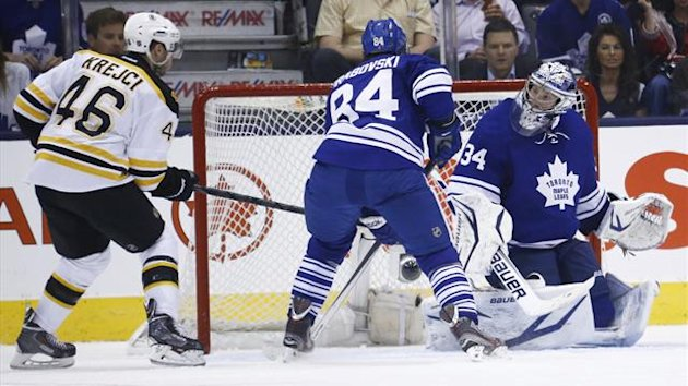 Boston Bruins' David Krejci (L) scores on Toronto Maple Leafs' James Reimer (Reuters)