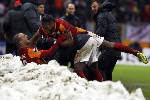 Galatasaray's Sneijder celebrates with his team mate Drogba after scoring a goal against Juventus during their Champions League soccer match in Istanbul