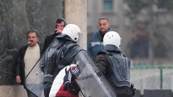 Police officers detain a protestor during a violent protest of a group of ethnic Albanians in Skopje, Macedonia, Saturday, March 2, 2013. Hundreds of ethnic Albanians staged a contra-protest on Saturday to express support for the designation of the new defense minister. Police said Saturday at least 20 people, from whom 13 police officers and other mainly youngsters were injured in a series of scuffles that erupted late on Friday and continued over night when a group of a few hundred Macedonians started a protest against the designation of a new defense minister Talat Xhaferi, an ethnic Albanian and former rebel commander. (AP Photo/Vangel Tanurovski)