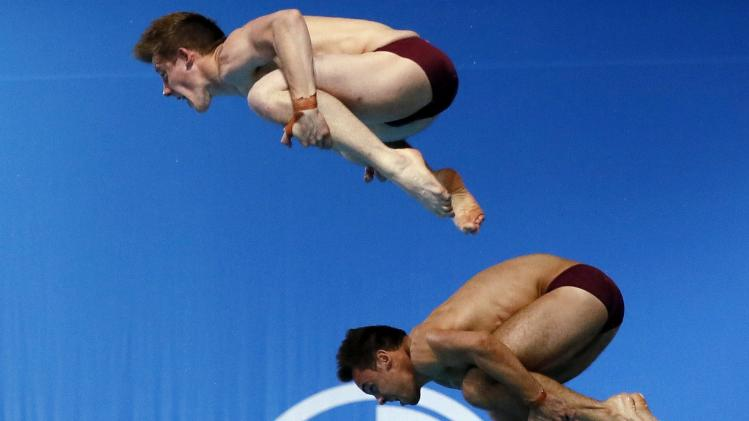 England's Daley and Denny dive during a practise session at the 2014 Commonwealth Games in Edinburgh
