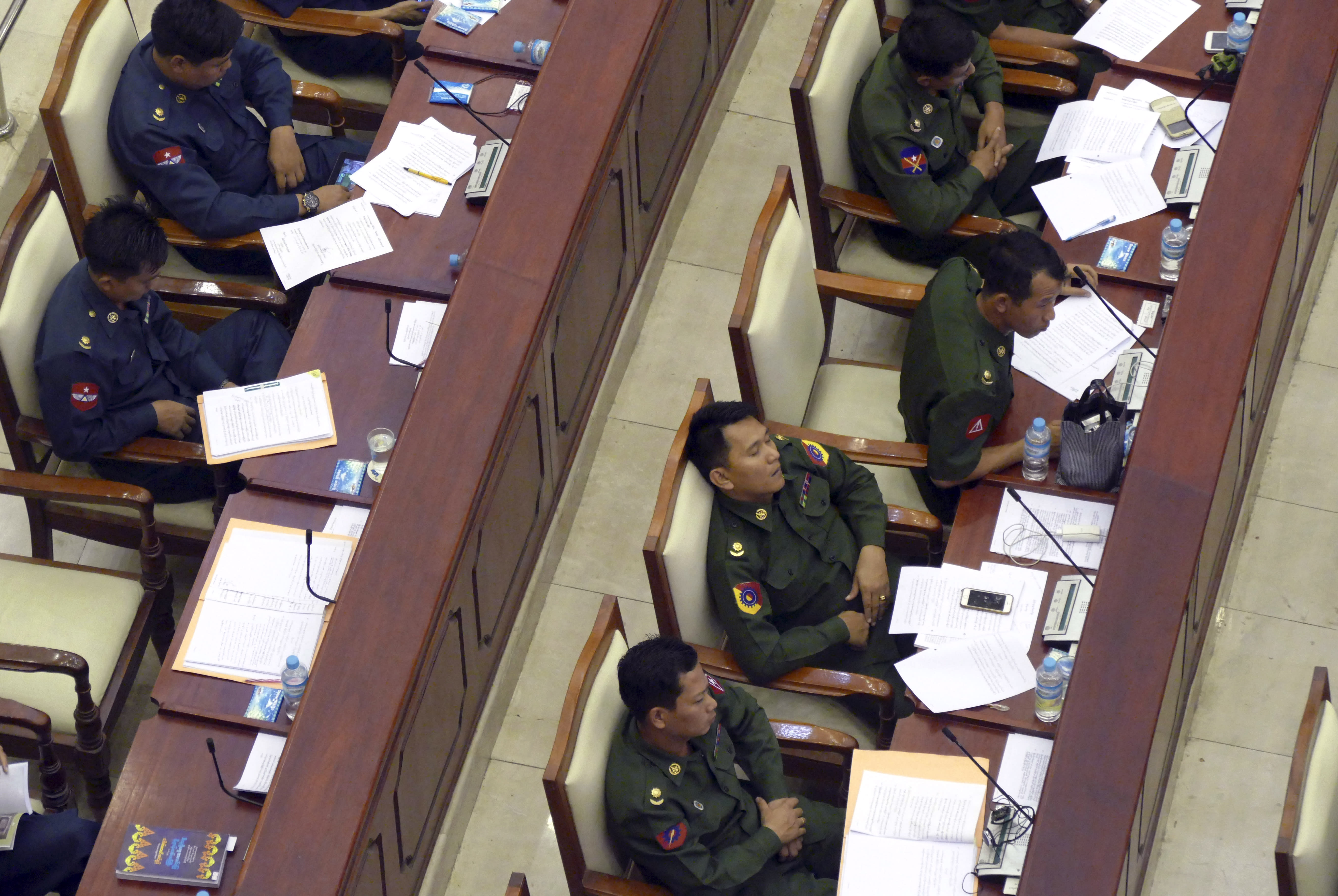 Myanmar restricts journalists after photos show sleeping MPs
