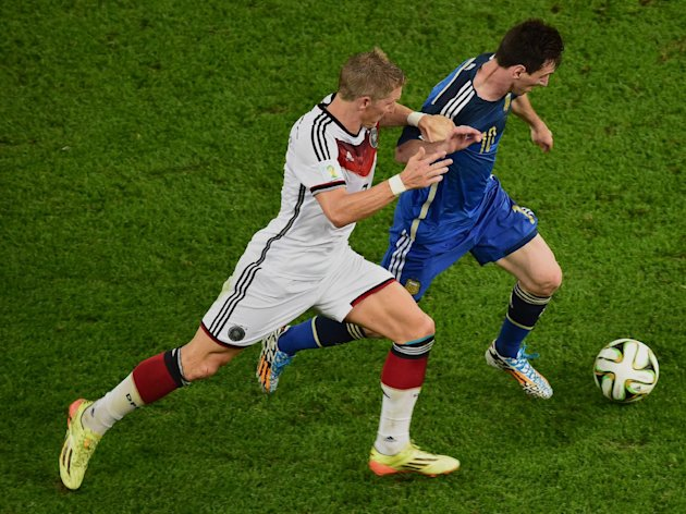Argentina's Lionel Messi, right, and Germany's Bastian Schweinsteiger vie for the ball during the World Cup final soccer match between Germany and Arg...