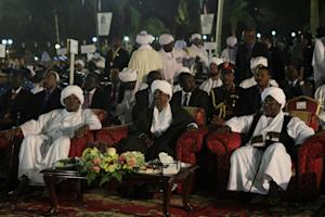 President Omar al-Bashir (centre) in December 2014 …