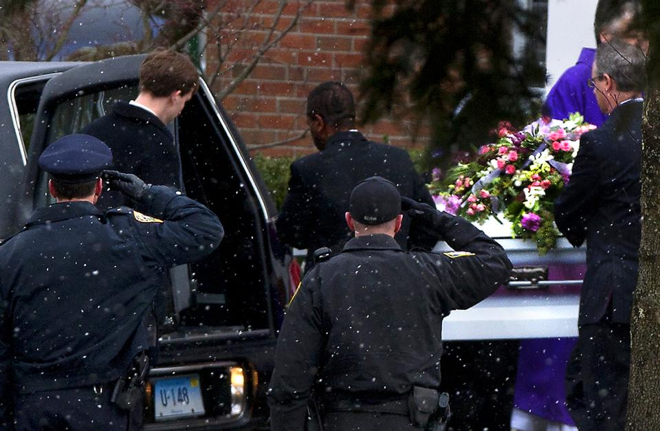 JOSEPHINE GAY, 7: Police salute as Josephine's casket is loaded into a hearse after her funeral service at St. Rose of Lima Roman Catholic Church, Saturday, Dec. 22, 2012, in Newtown, Conn. (AP Photo/The News-Times, Cody Duty)