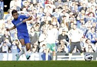 Chelsea's midfielder Eden Hazard scores their third goal during the English Premier League football match against Norwich City at Stamford Bridge in London. Chelsea won 4-1