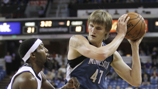 Miinnesota Timberwolves forward Andrei Kirilenko, right, protects the ball from Sacramento Kings forward John Salmons during the first quarter of an NBA basketball game in Sacramento, Calif., Tuesday, Nov. 27, 2012.(AP Photo/Rich Pedroncelli)